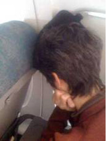 Sleeping in an airplane seat