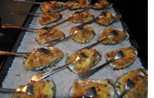 Broiled oysters topped with smoked bacon, smoked Gouda and caramelized onions