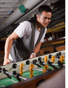 Young man playing foosball