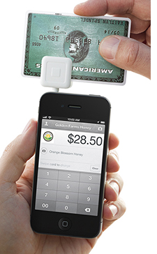 Running a credit card through the square reader